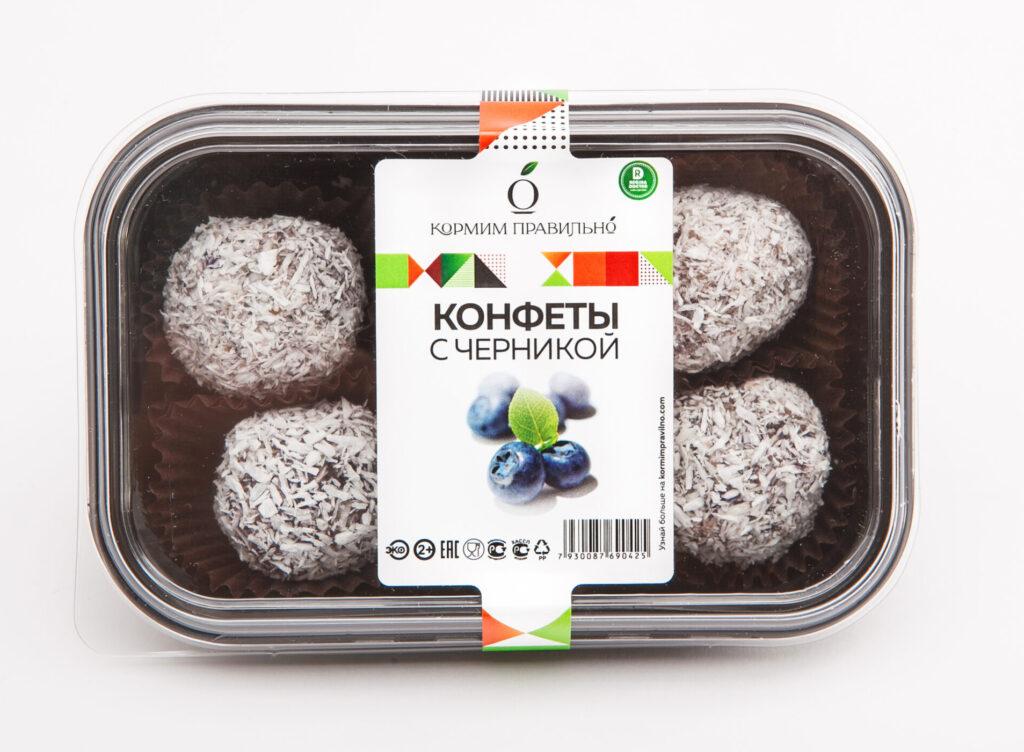 Этикетка на пленке со сложной высечкой на контейнеры | коробки с черничными конфетами